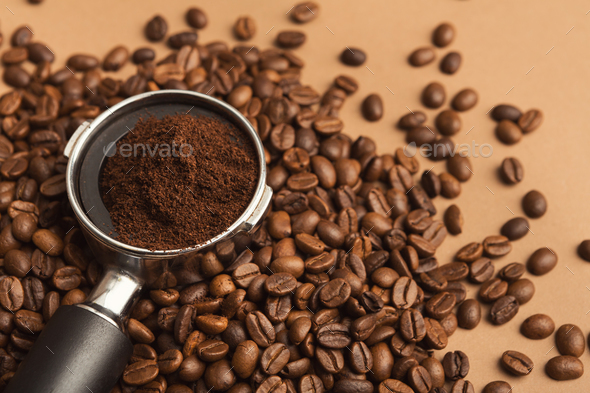 Coffee machine holder with ground roasted beans - Stock Photo - Images