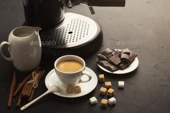 Coffee cup and sweets on black table - Stock Photo - Images