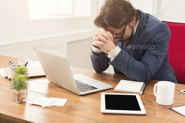 Overworking tired businessman at workplace - Stock Photo - Images