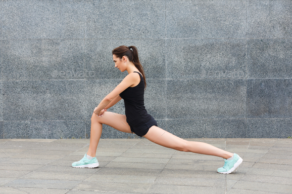 Fitness woman at stretching training outdoors - Stock Photo - Images