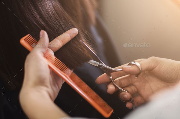Cropped shot of female client receiving a haircut - Stock Photo - Images