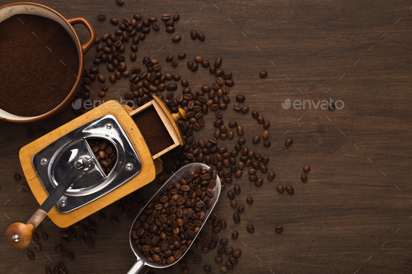 Retro coffee grinder on old wooden table, top view - Stock Photo - Images
