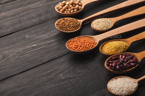 Various gluten free groats on wooden background, copy space - Stock Photo - Images