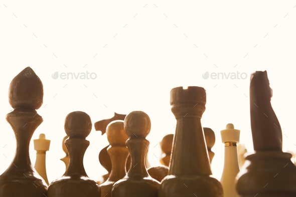 Silhouettes of chess figures on white background - Stock Photo - Images