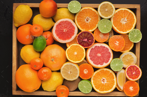 Assorted cirtus fruits background, top view - Stock Photo - Images