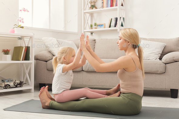 Play clapping hands together with mum - Stock Photo - Images