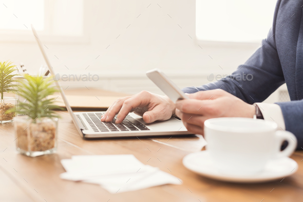 Unrecognizable businessman typing on laptop - Stock Photo - Images
