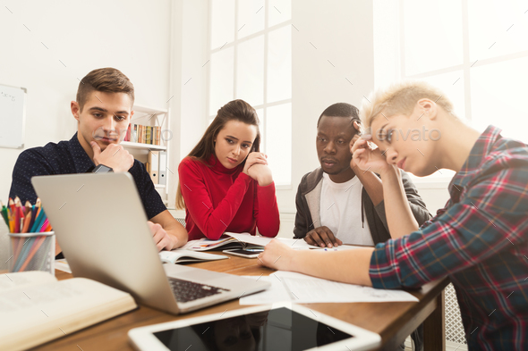 Multiethnic classmates preparing for exam together - Stock Photo - Images