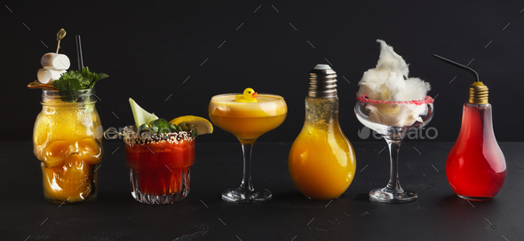 Variety of creative cocktails on black background - Stock Photo - Images