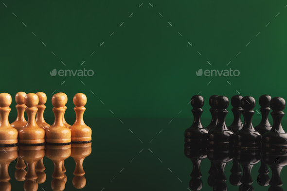 Chess figures on green background with reflection - Stock Photo - Images