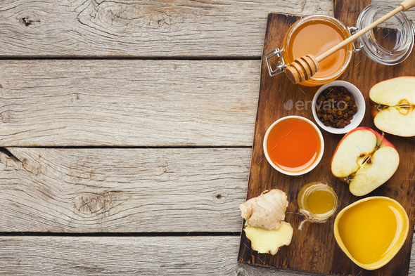 Various types of honey on wooden background, top view - Stock Photo - Images