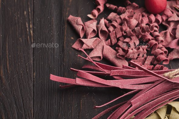 Assorted italian red pasta on wooden background - Stock Photo - Images