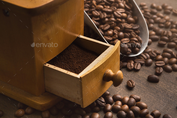 Retro coffee grinder on old wooden table, closeup - Stock Photo - Images