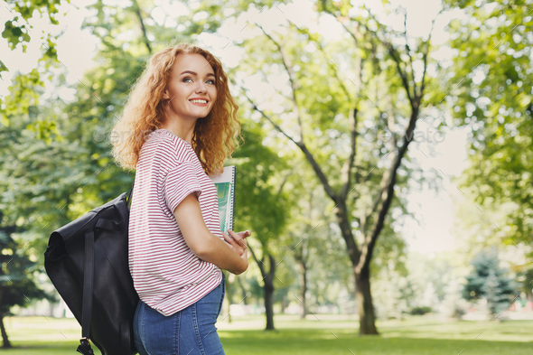Student girl with books in park outdoors - Stock Photo - Images