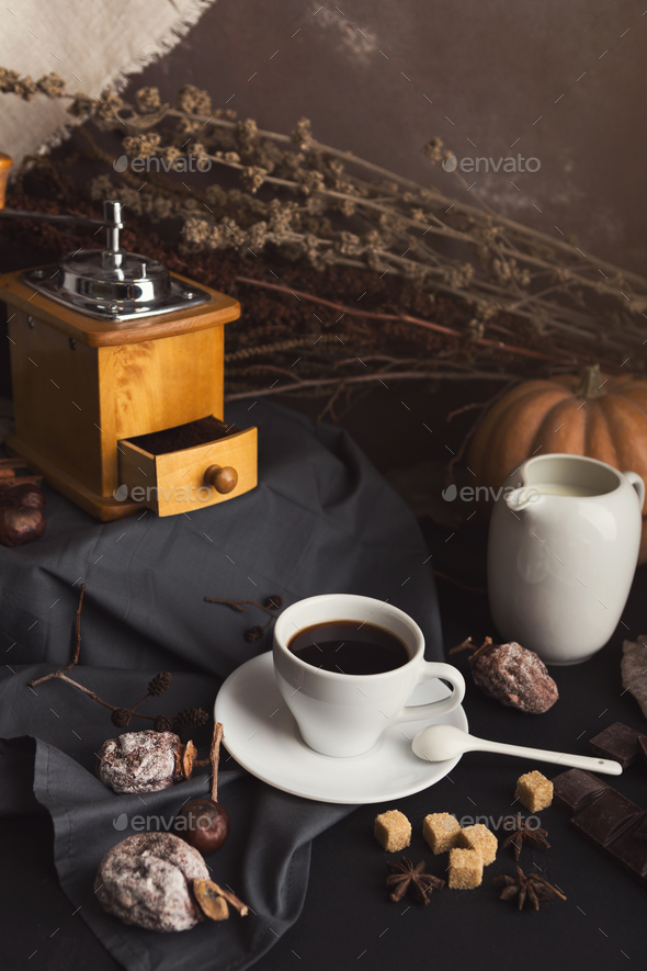 Coffee cup and sweets on vintage wooden table - Stock Photo - Images