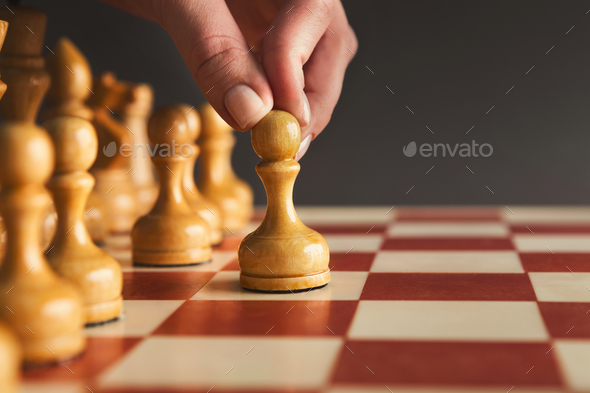 Hand of player chess board game putting white pawn - Stock Photo - Images
