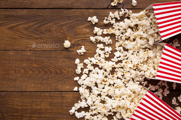 Bucket of popcorn on wooden background, top view - Stock Photo - Images