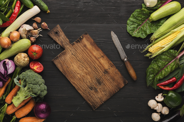 Fresh organic vegetables on wood background. - Stock Photo - Images