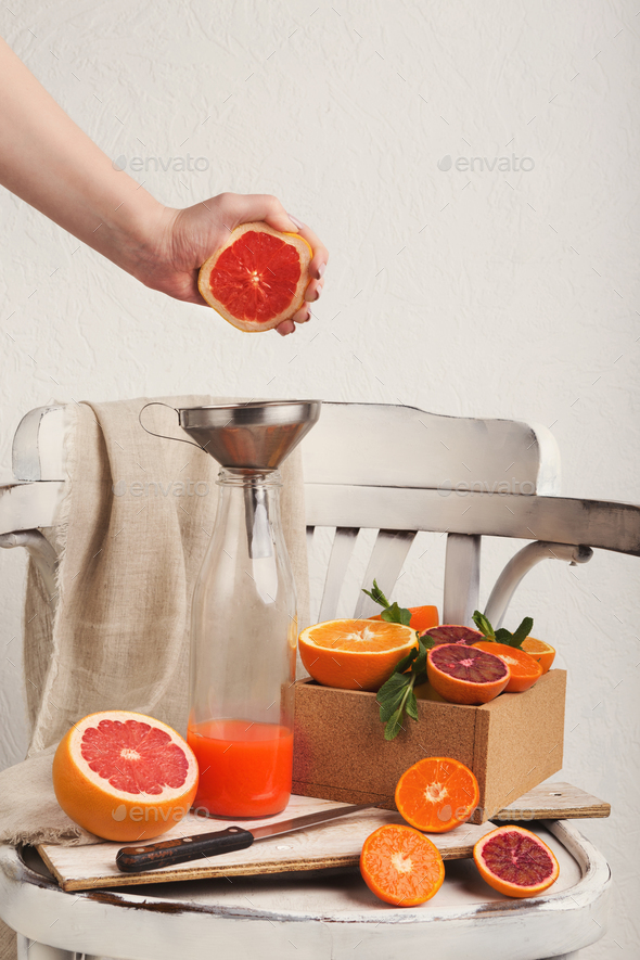 Preparing citrus fresh on white old chair - Stock Photo - Images
