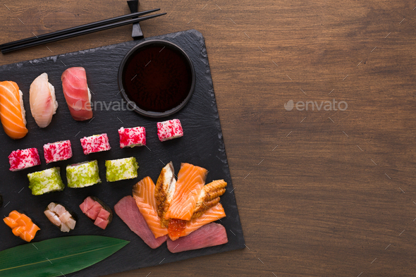Set of assorted sushi, maki and rolls on rustic wooden background - Stock Photo - Images