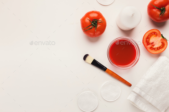 Handmade tomato face mask for home skin care - Stock Photo - Images