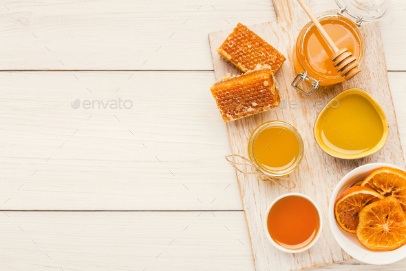 Variety of honey on white wooden planks, top view - Stock Photo - Images
