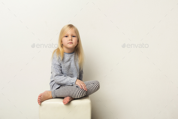 Cute happy little girl portrait in studio - Stock Photo - Images