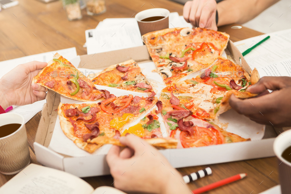 Students learning and eating pizza - Stock Photo - Images