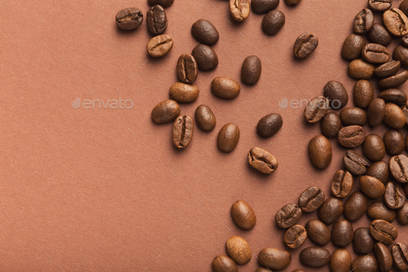 Heap of brown coffee beans on pink background - Stock Photo - Images