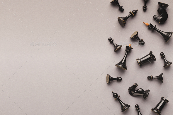 Chess figures on gray table background - Stock Photo - Images