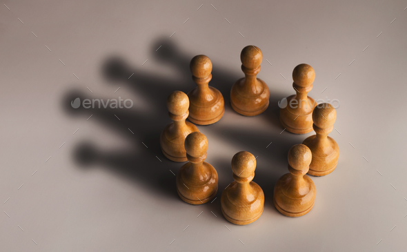 Chess pawn circle with shadow shaped as crown - Stock Photo - Images