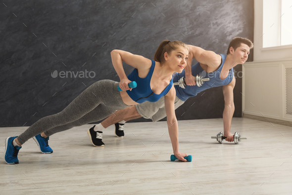Couple making plank or push ups exercise indoors - Stock Photo - Images