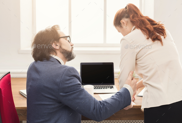 Sexual harassment at work, back view - Stock Photo - Images