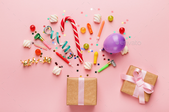 Birthday party background with gift and lollipops - Stock Photo - Images
