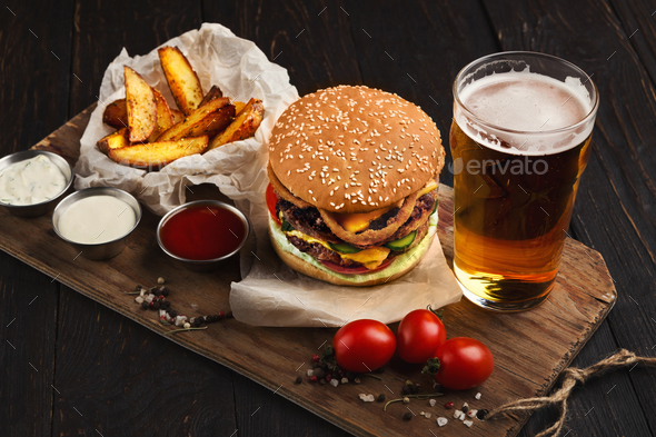 Fast food restaurant dish. Hamburger and fries wedges - Stock Photo - Images