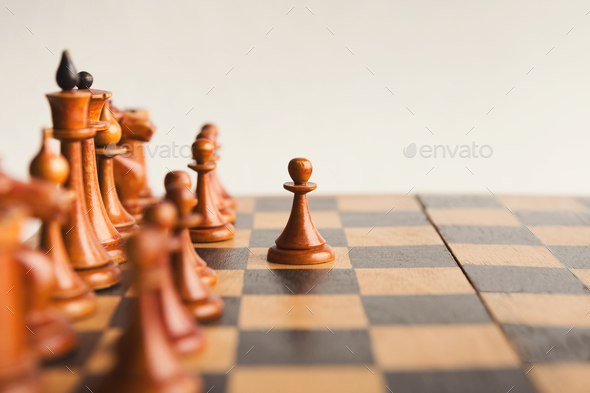 White pawn moves on chessboard - Stock Photo - Images