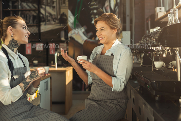 Experienced barista and her student sharing experiences - Stock Photo - Images