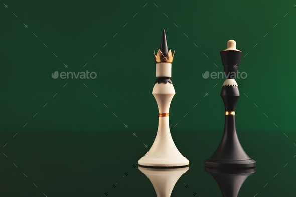 Pair of king chess pieces confronted as opposites - Stock Photo - Images