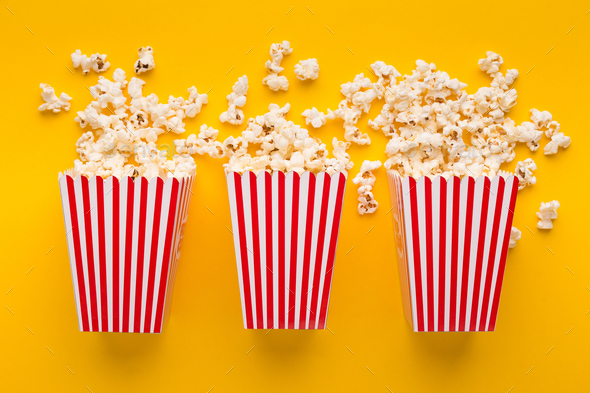 Buckets of popcorn on yellow background, top view - Stock Photo - Images