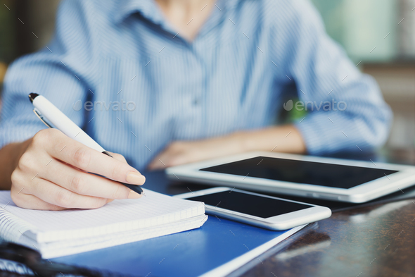 Female hand writing notes closeup outdoors - Stock Photo - Images