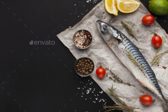 Mackerel and cooking ingredients on black background - Stock Photo - Images