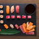 Set of assorted sushi, maki and rolls on rustic wooden background - PhotoDune Item for Sale