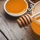 Closeup of liquid honey on wooden background - PhotoDune Item for Sale