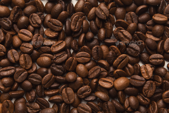 Closeup of coffee seeds, textured background - Stock Photo - Images