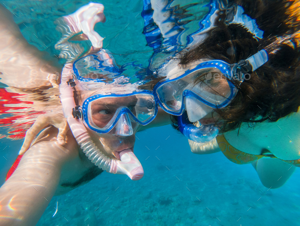 Couple snorkeling underwater in the Red sea - Stock Photo - Images