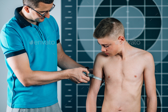 Physical Therapist doing Anthropometric Measuring of arm - Stock Photo - Images