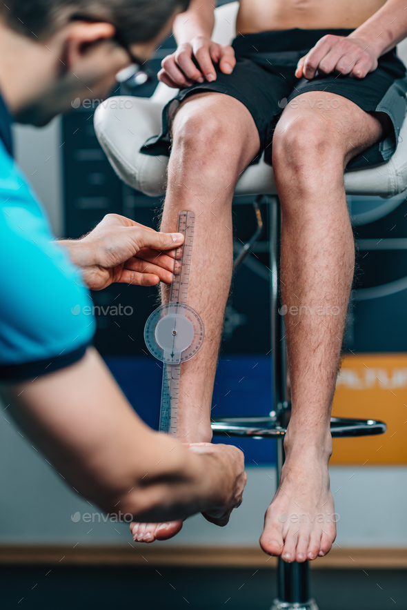 Physical Therapist doing Anthropometric Measuring - Stock Photo - Images