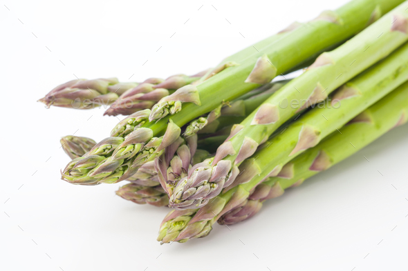 whole raw green asparagus on white background - Stock Photo - Images