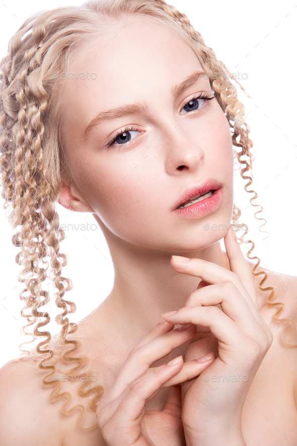 Portrait of a beautiful woman with curly blonde hair - Stock Photo - Images