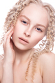 Portrait of a beautiful woman with curly blonde hair - PhotoDune Item for Sale